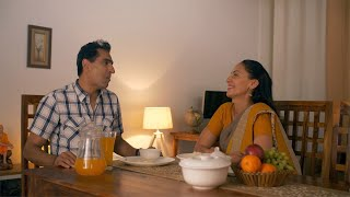 Indian married couple spending quality time together while having lunch at home. Couple from India