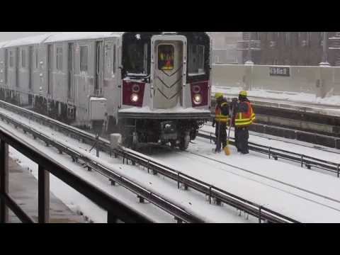 Blizzard special  at 46st w/ surprise R62A and R188 test/snow clearing train not in service!