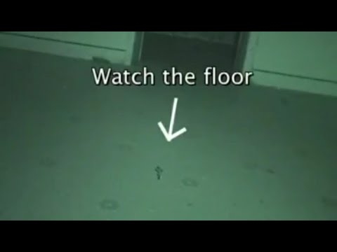Unseen Force Pushes a Crucifix Up Through the Floor   Ghost Caught on Camera