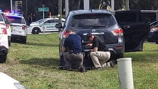 'Multiple people shot' and others taken hostage after 'mass shooting' at bank in Florida