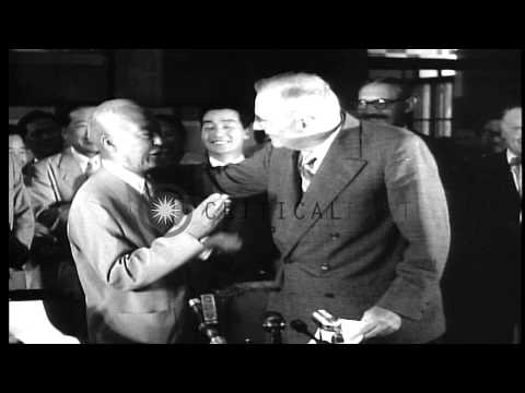 Signing of the US-Korean Mutual Defense Treaty by John Foster Dulles and Y.T. Pyu...HD Stock Footage