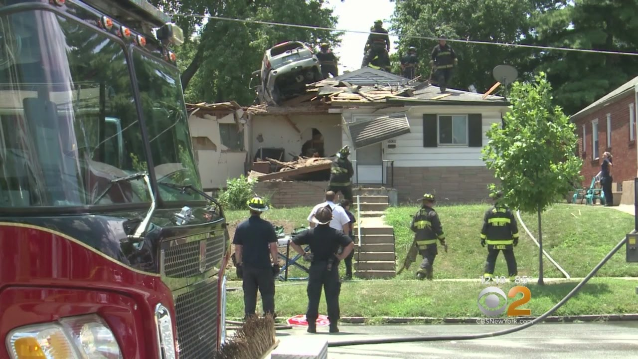 Suv Lands On Man S Roof After Going Airborne In Speeding Accident