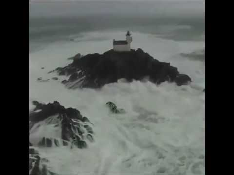 Lighthouse in Tsunami waves