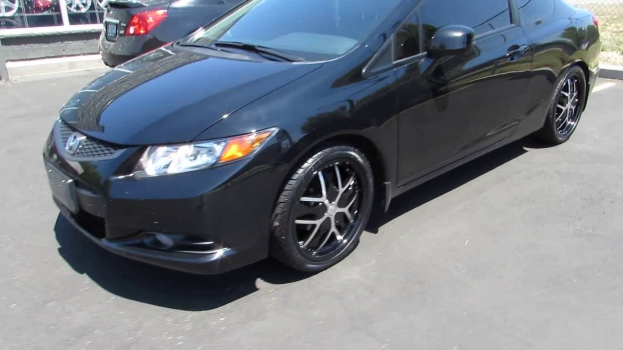 2015 honda civic coupe riding on 18 inch custom black rims
