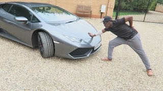 PUSHING A LAMBORGHINI WITH ONE HAND!!!