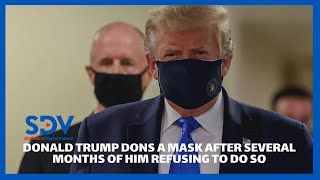 Donald Trump dons a face mask for the first time