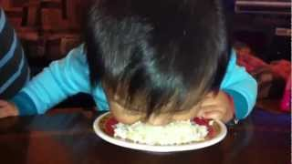 Baby eats rice on her own!