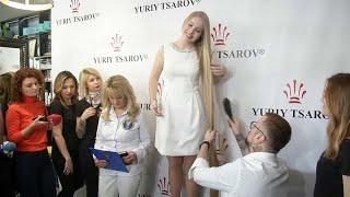 """شاهد: الأوكرانية أولينا كورزنيوك صاحبة الشعر الأشقر """"القياسي""""…"""