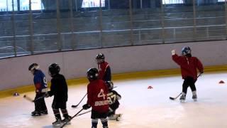 Matthias scores a backhanded goal at hockey practice