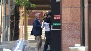 Raw Video: Hostages Flee Sydney Café Under Siege