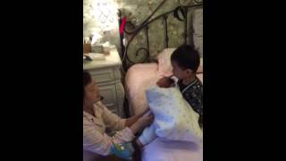 little Chinese kid singing to his little brother