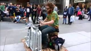 Street Artist Entertains With Unique Booming Pipes