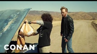 Conan O'Brien Drives an Explosives-Packed Car Off A Cliff!