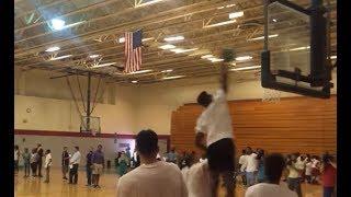 Jaylen Brown dunks on child