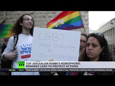 Israeli activists hang LGBT flag on chief rabbi's office in protest at anti-gay remarks