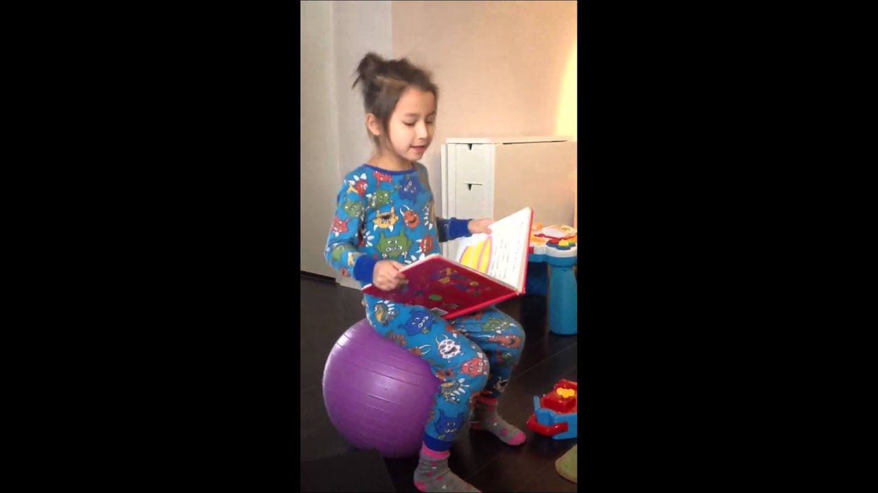 Ania Reading A Nursery Rhyme While Bouncing On A Yoga Ball