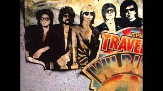 Watch Traveling Wilburys You Took My Breath Away video