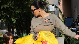 X17 EXCLUSIVE: Kim Kardashian Hides Her Bum Behind Bags Of Toys For Nephew Mason