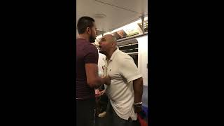 Man gets choked out with a Rear naked choke on the subway in NYC.