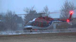 Helicopter taking off and coming down because of weather