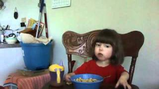 3 year old with arthrogryposis eating cerial with milk