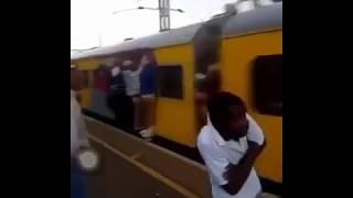 Boy get slapped on platform by a guy in running train