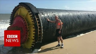 Giant pipes wash up on beaches - BBC News thumbnail