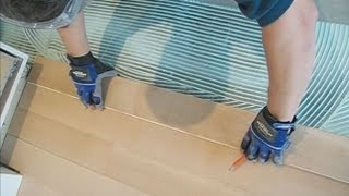 Unfinished Hardwood Floor Installation Around Kitchen Cabinets