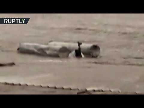 Raging floods rip down a bridge near Austin, Texas