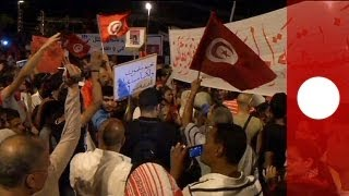 Opposition protesters take to the streets calling for Tunisia