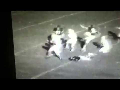Young Brian Sussman (in white) scores on a 46-yard run