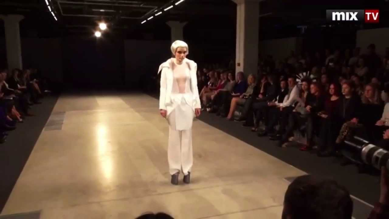 Model in super high platform heels falls down during Janis Sne 2013 fashion show