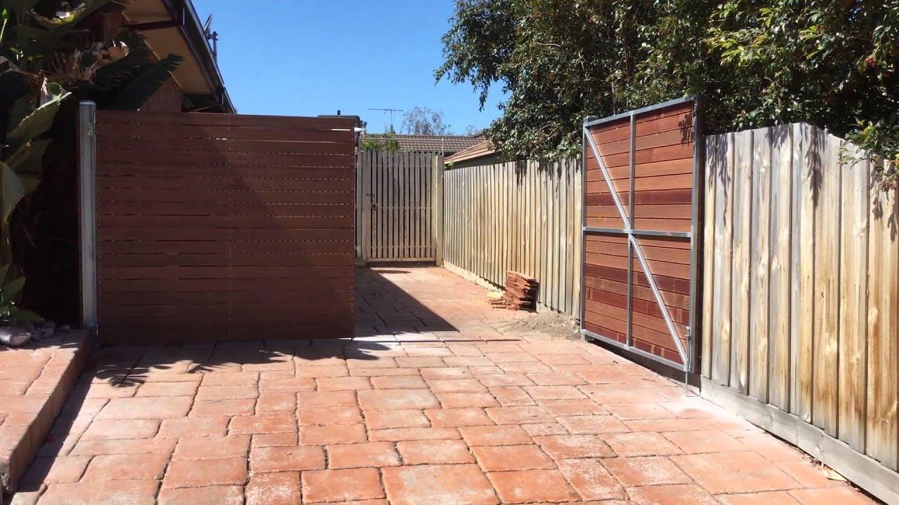 Horizontal merbau double driveway gates. Nailed it Fencing ...