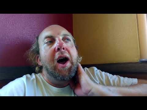 Corky chugs down cheap box wine  while living at a sober living facility