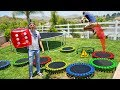 GIANT Trampoline Board Game in our Backyard!! *DONT LAND ON TRAPS*
