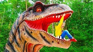 Senya and Dad Play in the Dinosaur Park
