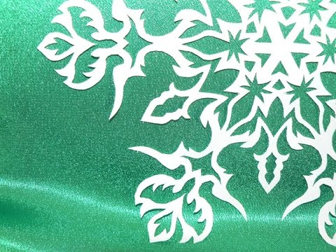 Как наклеить бумажные снежинки на окно