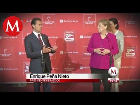 Peña y Merkel conviven con robot en la Feria de Hanover