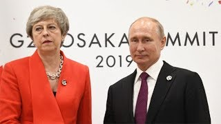 Theresa May and Vladimir Putin hold tense meeting.