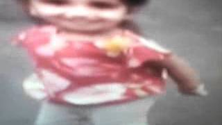 Cute little baby girl dancing on Indian music