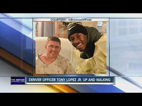 Denver officer Tony Lopez Jr. up and walking
