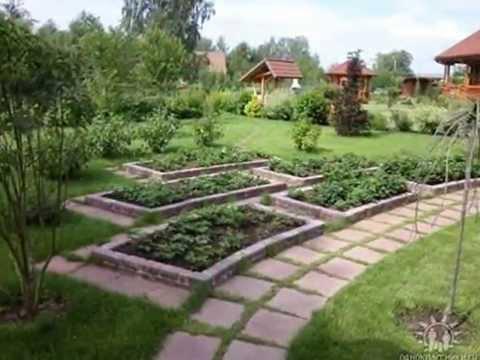 Cмотреть видео Дизайнерские красивые грядки в саду