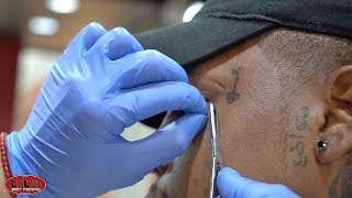 SURFACE PIERCING STUCK ON HIS FACE!!