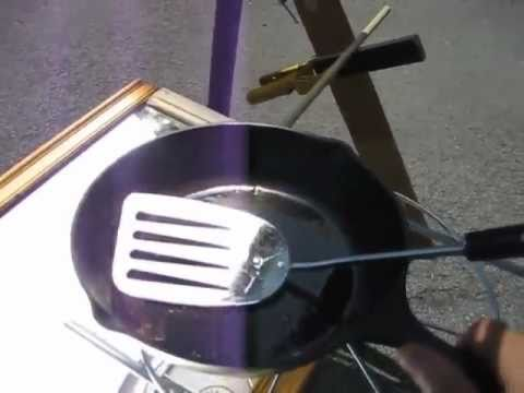 Fresnel lens and mirror solar cooker cast iron pan