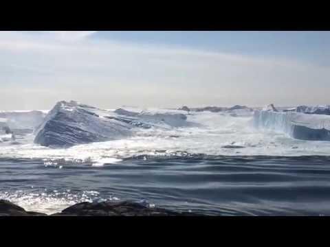 Ilulissat Icefjord - Large iceberg breaking over
