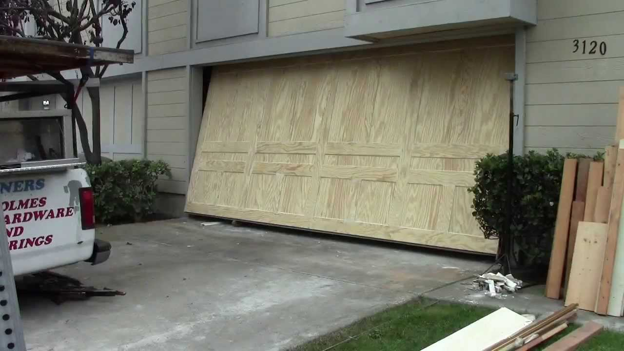 a 1 garage doorsA wood one piece garage door  YouTube