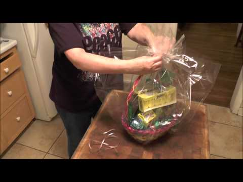 How to wrap a Gift Basket with Cello and then put on a Bow