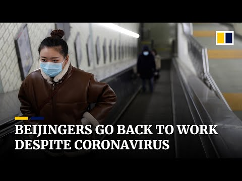 Beijingers gradually return to work as China's fight against deadly coronavirus continues