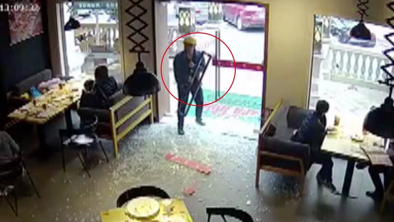 Chinese Delivery Man Walks Through Glass Door