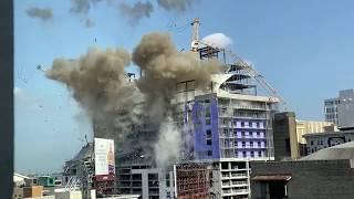 Slow-motion video of Hard Rock Hotel collapse site crane demolition